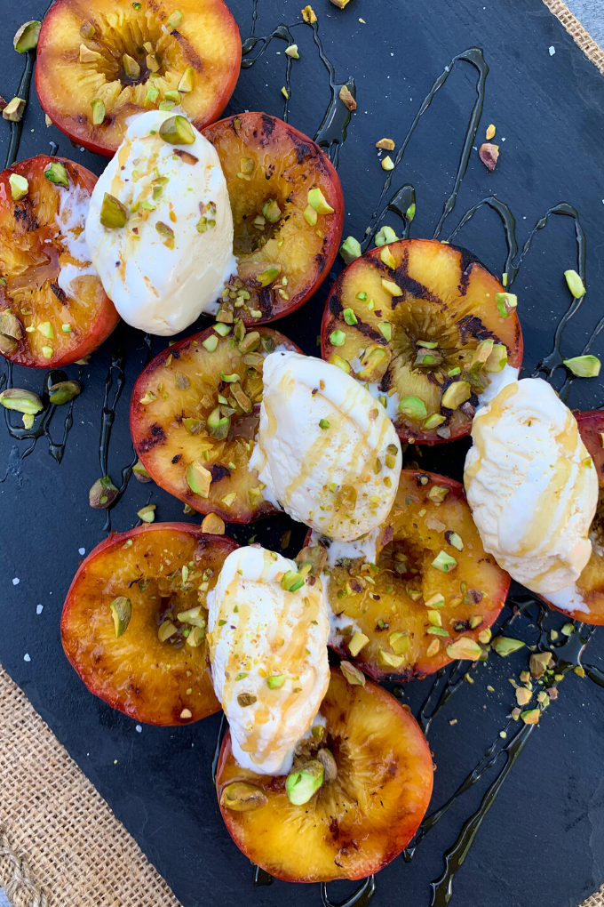 Grilled Peaches with pistachio, honey and ice cream