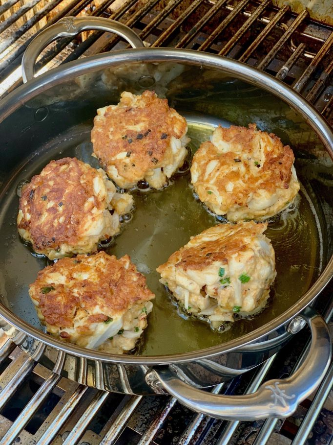 Cooking crab cakes on the grill