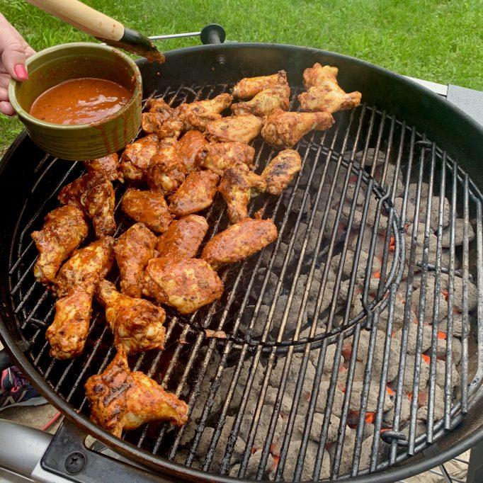 Baste chicken with marinade