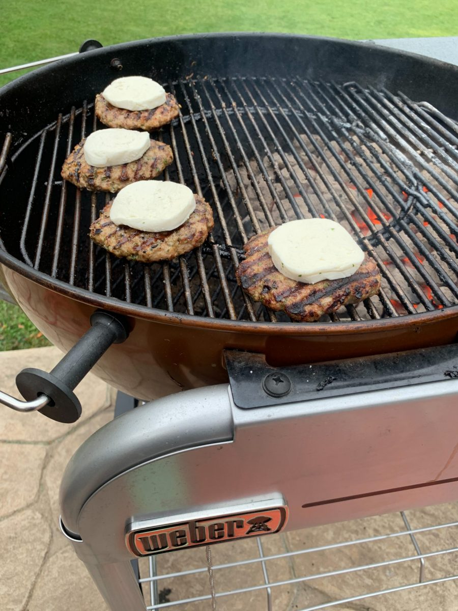 Pork burgers topped with mozzarella on Weber Performer