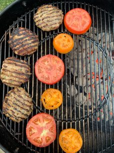 Grill pork burgers and tomato