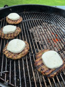 Pork burgers topped with fresh mozzarella