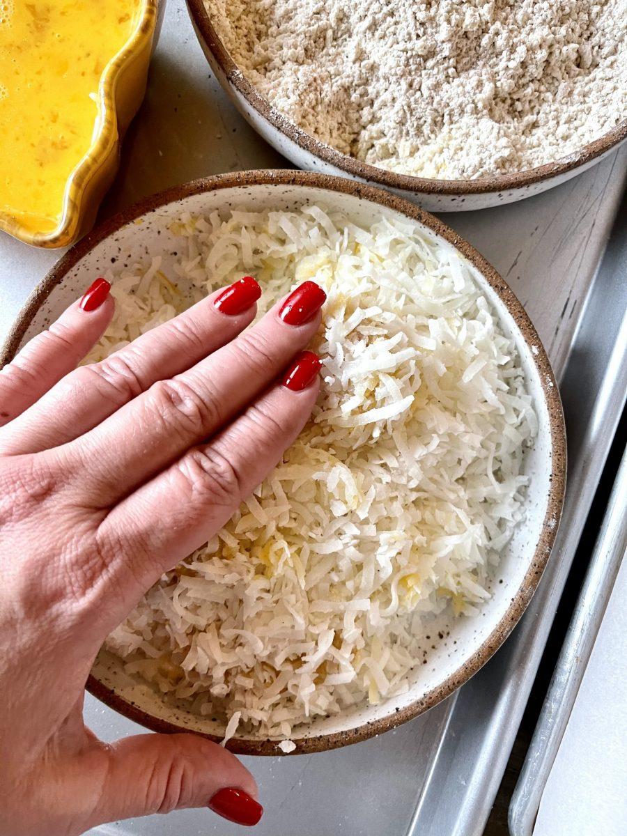 Pressing Battered Shrimp Into Shredded Coconut