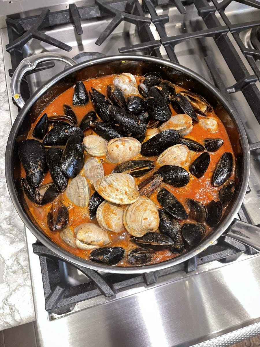 Add clams and mussels to broth then cover with lid until shells open fully