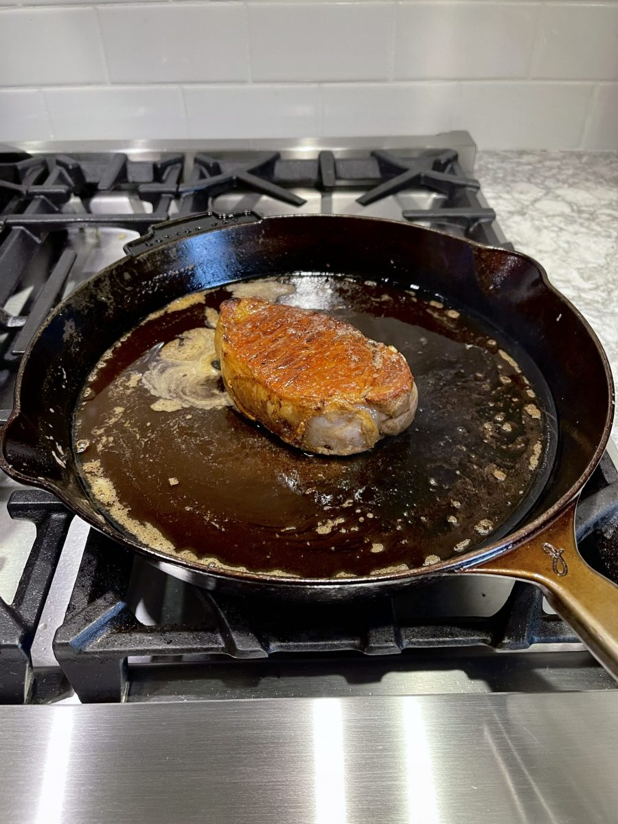 Cooked Pork Chop In Cast Iron Skillet