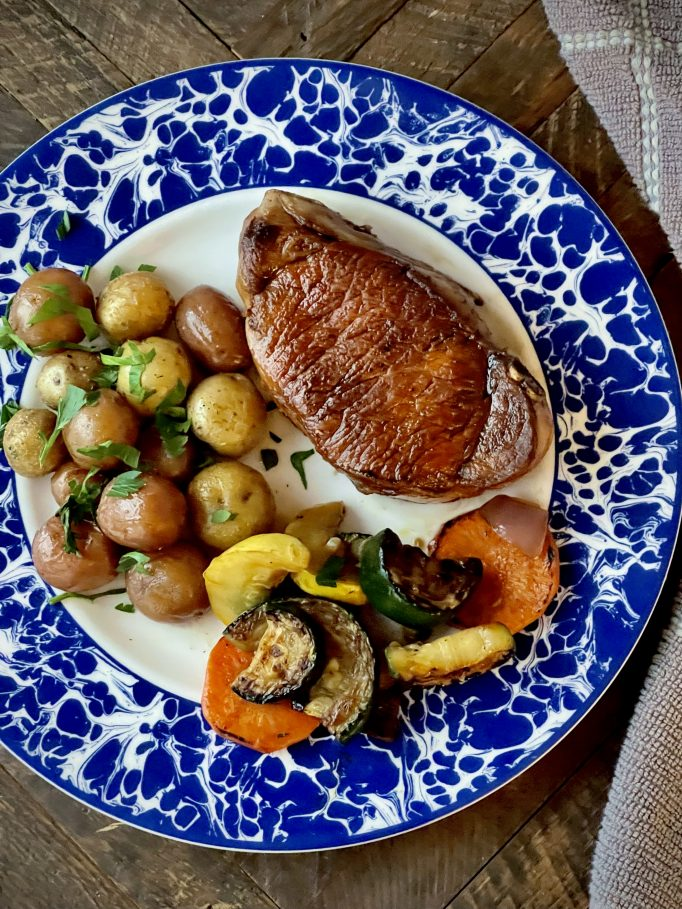 Pork Chops With Baby Potatoes And Mixed Vegetables