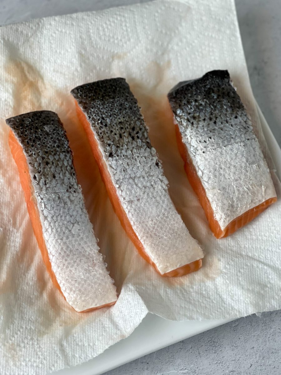 Drying The Surface Of The Salmon Filets To Promote Better Browning and Crisping Of Skin