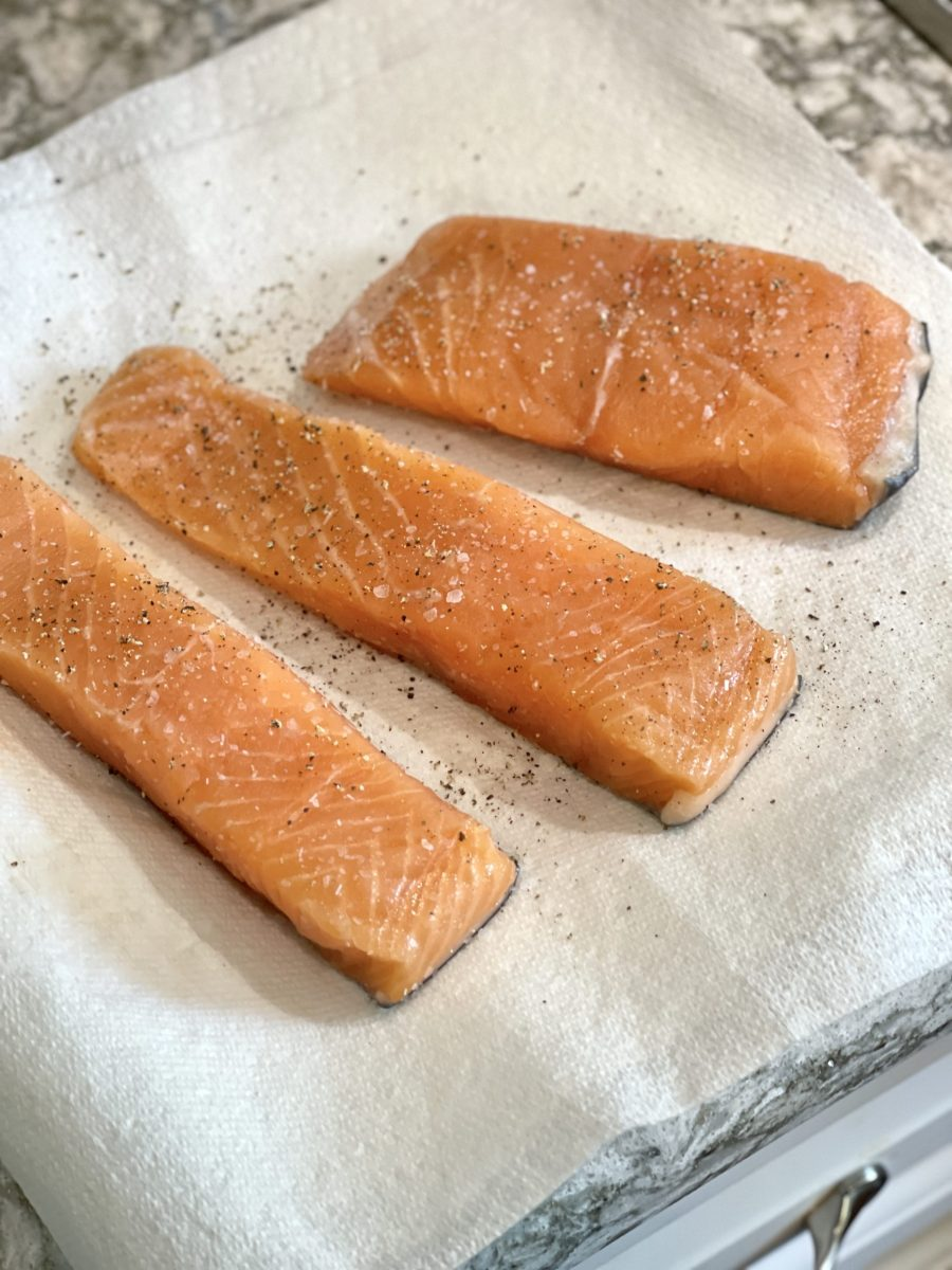 Salmon Filet Portions Seasoned With Salt And Pepper