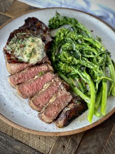 a picture of a strip steak with garlic herb butter