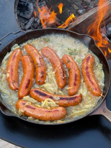 Brats Cooked In Beer In Cast Iron Skillet